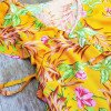 Yellow wrap dress with flowers